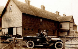 Woods Lightning Protection installed Lightning rods on this barn in Deposit, New York in 1914. Philip Woods is driving the first company truck in the foreground. Founder Frank A. Woods is in the car to the left